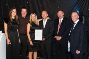 Gareth Davey, Philip Woodward and Philippa Sturdy of North Lincolnshire Homes are presented with their CORGI Accredited certificate by Charlie Webster, TV Sports presenter, Chris Bielby, President of the AGSM and Bill Paton, Chairman of CORGI Technical Services